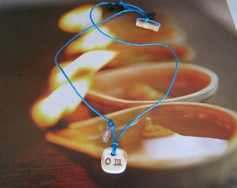 Earth Friendly OM Porcelain Necklace on Turquoise Hemp Cord w/ a Bamboo Closure