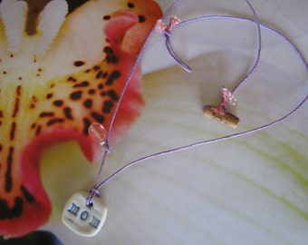 Earth Friendly MOM Porcelain Necklace with a Cherry Quartz Bead on Lilac Hemp Cord