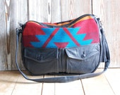 SALE... Tundra in reclaimed black leather and navajo fabric