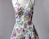 RESERVED..... vintage 1940s Bathing suit swimsuit  Playsuit romper Catalina floral