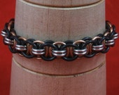 Black, Silver, And Bronze Helm Chain Bracelet