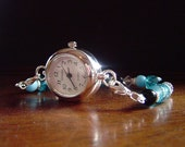 Crystal and turquoise with black and silver watch