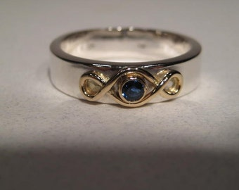 Sterling Silver Band with a 14kt Gold Eternity Knot and Blue Sapphire Set in 14 kt Gold ... Gents ... Made to Order in Your Size