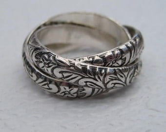 Petite Flower ... Rolling Ring ... Sterling Silver ... CooL ...