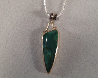 Damale Mine Nevada Turquoise Sterling Silver with Goldfill wire adornments ...  Pendant   ...... E29
