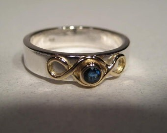 Sterling Silver Band with a 14kt Gold Eternity Knot and Blue Sapphire Set in 14 kt Gold ... Ladies ... Made to Order in Your Size