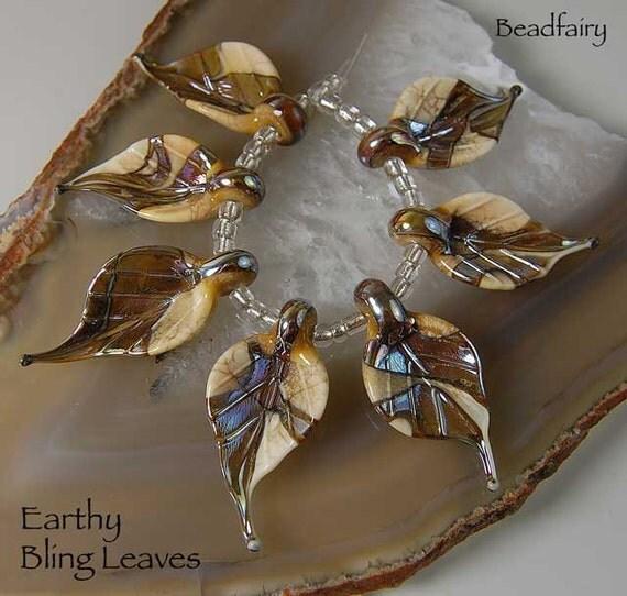 Earthy Bling Leaves, 7 handmade glass beads, leaves  ivory-gold by Beadfairy Lampwork, SRA