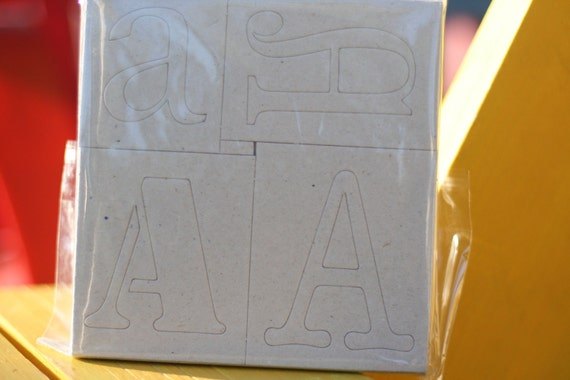 Chipboard letters/alpha brand new in package 4 of each letter