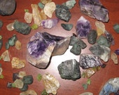 Please see description- Raw Uncut Gemstones Amethyst Emeralds Rubies Moonstone Citrine and More