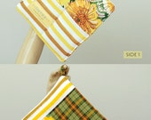 yellow floral . hot pad