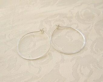 Simple hammered sterling silver hoop earrings
