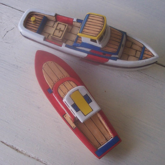 Red and White Toy Wooden Boats
