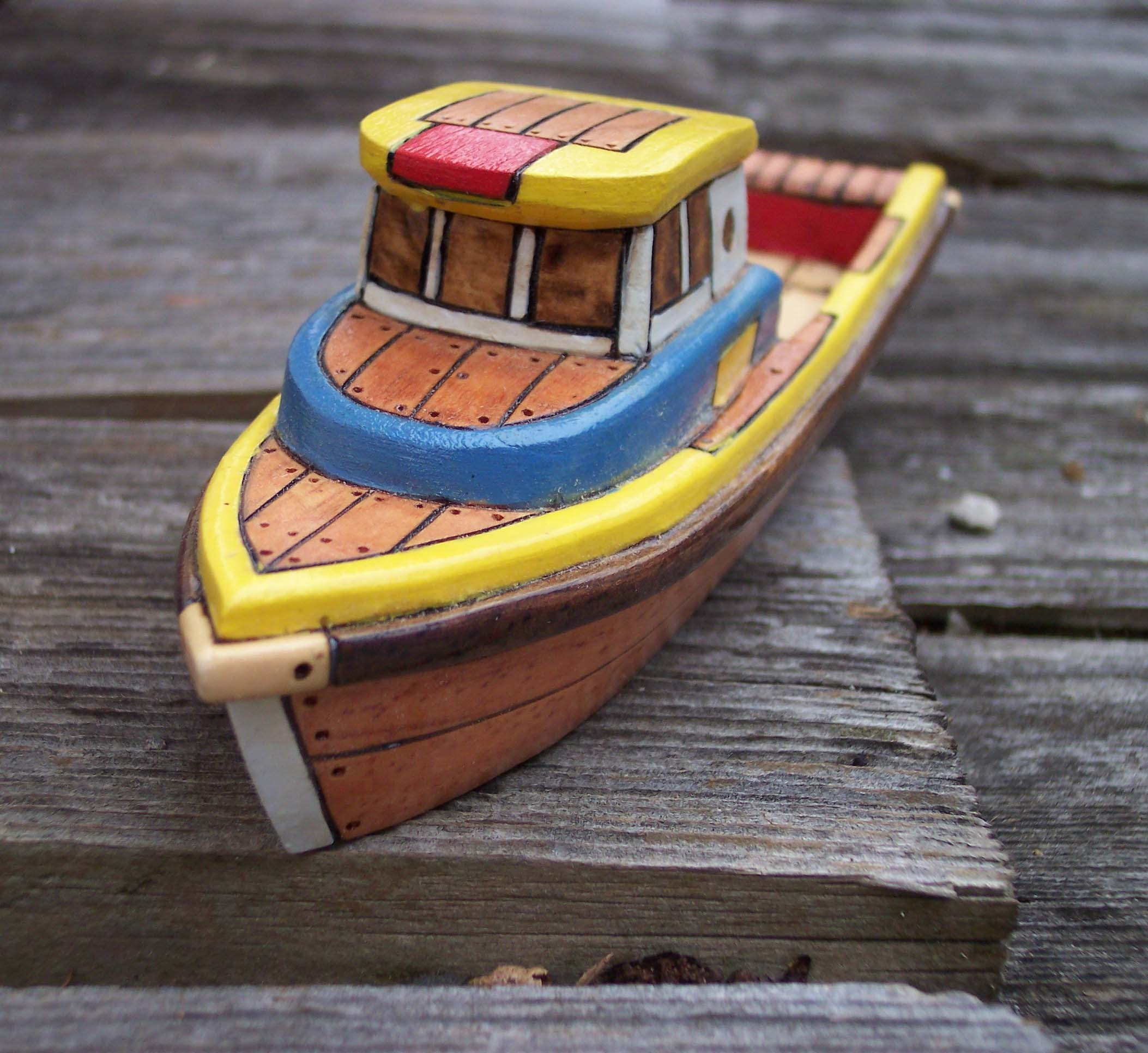 Yellow and Blue Toy Wooden Boat