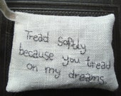 Lavender sachet in linen with embroidered text 'Tread softly because you tread on my dreams'