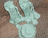 Hand knitted cabled knee high booties with matching cabled hat in sweet pea green