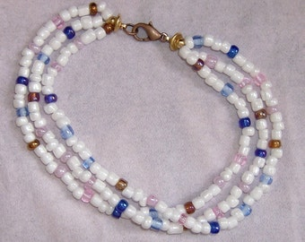 hand strung white, blue, pink 4mm beads with copper clasp 7.5 inch bracelet