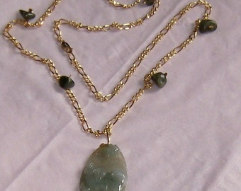 gold chain with jade shards pendant is a hand carved plush dog 24 inch necklace