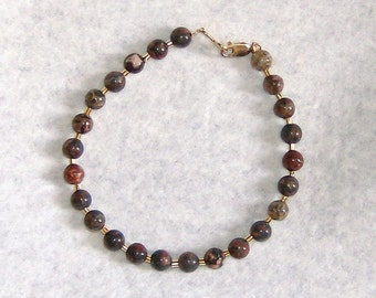 leopardskin jasper 6mm round beads bracelet in 22k gold lobsters claw clasp