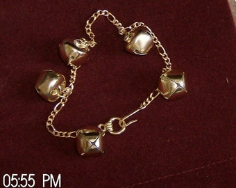 five golden bells on a 7 inch golden chain bracelet