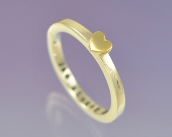9k yellow gold heart atop a 9k white gold ring. Personalised with your message inside.