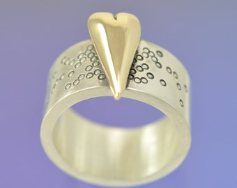 Large 9k Yellow Gold Heart atop a Silver Ring.