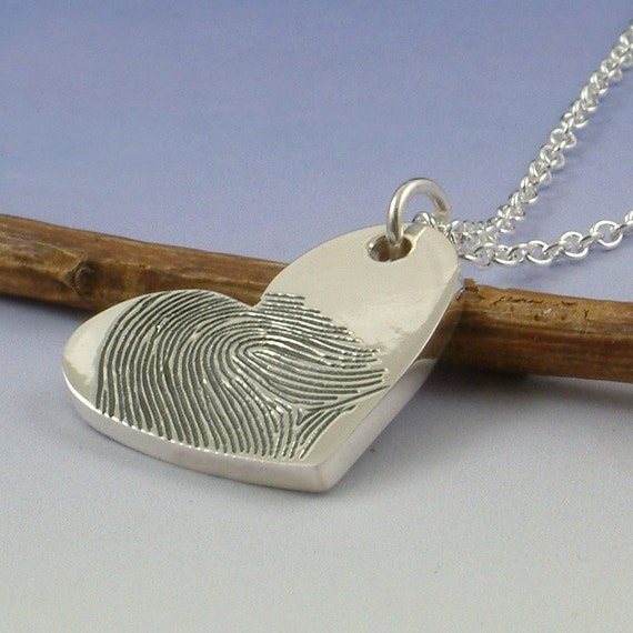 Fingerprint pendant. Your finger print hand engraved onto a sterling silver heart shaped pendant.