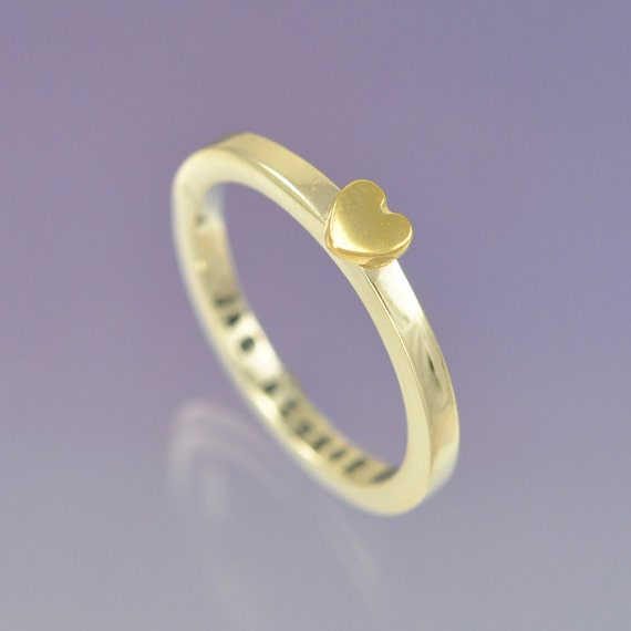 9k yellow gold heart atop a sterling silver ring. Personalised with your message inside.