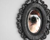 Midnight black oval mirror