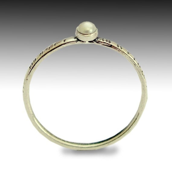 Time out -  a tiny, thin, grooved sterling silver band inlaid a fresh water pearl.