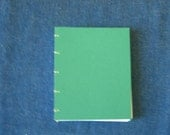 Green journal with mat-board cover
