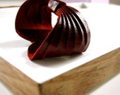 propeller LEATHER cuff. CRIMSON. salvaged materials. free shipping.