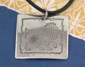 Silver Pendant with etched Lion