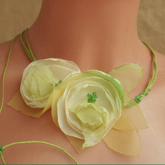 Ivory/green Spring flowers on cord--neck piece---necklace
