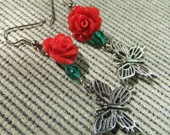 Pewter Butterfly Charms Below Molded Red Resin Roses and Green Crystal Beads Dangle Earrings