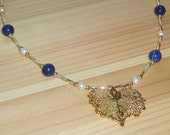 Sale Apollo's Golden Leaf in Lapis Lazuli, Gold, and Pearls