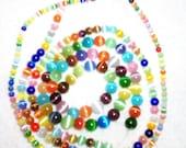 Three strands of Cats Eye Beads....DESTASH