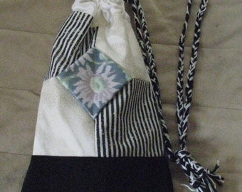 Upcycled and Reconstructed Black and White Drawstring pouch or hip bag Quilted and sown