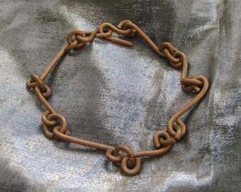 Scrolling copper bracelet