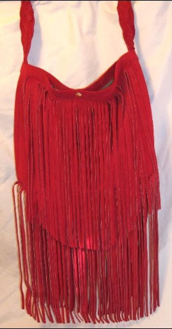 red suede handbag