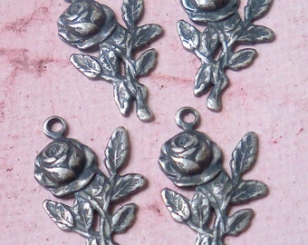 4 Vintage Silver Ox Rose Charms