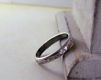 Sterling Band with flush set stone