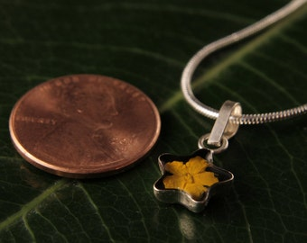 Sterling Silver Miniature Pressed Yellow Flower Star Shape Pendant Black Background