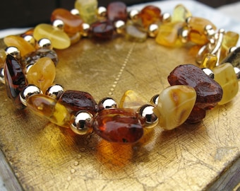 Chunky multi colored amber nugget and gold bead necklace