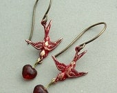 Evening flight, Red patina brass birds with glass hearts