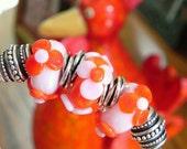 Three Orange and Pink European Charm Big Hole Beads