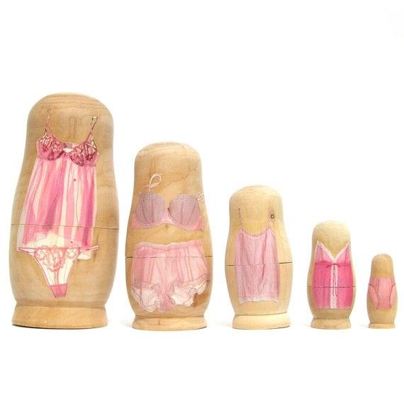 PINK SLIPS, nesting dolls
