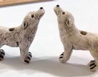 2 white ceramic howling wolvesFrom Gems4us