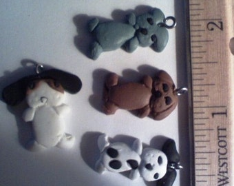 4 different clay puppy charms