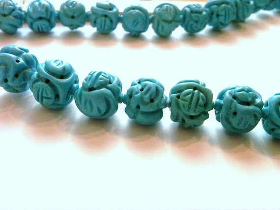 6 Turquoise Colored Carved Beads