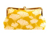 Clutch purse with ginkgo leaves on mustard
